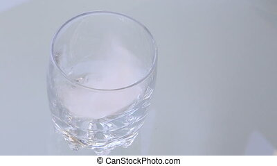 pouring water and ice cubes - Shot of pouring water and ice...
