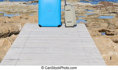 Suitcases on the pier near the sea - Suitcases near the sea....