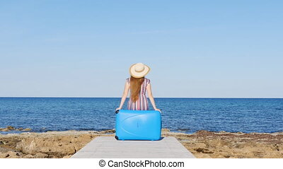 Woman with suitcase on the beach - woman with suitcase on...