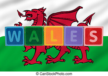 wales and flag in toy block letters