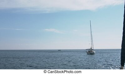 Sailing ships on the high seas. Luxury yachts in open sea
