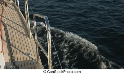 Side view of yacht, sailing in open sea - Side view of...
