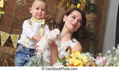 The mother and the son and the Easter Bunny in the beautiful...
