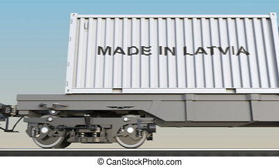 Moving cargo train and containers with MADE IN LATVIA...