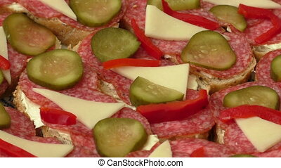Small snacks canape with salami, cheese and pickle