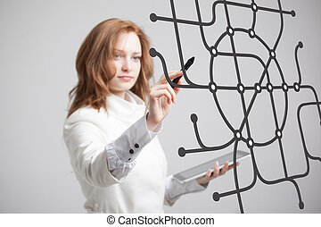 Woman specialist and urban planner working with the interactive subway map.