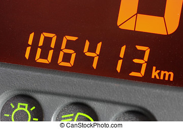 odometer of used car showing mileage of 106413 km