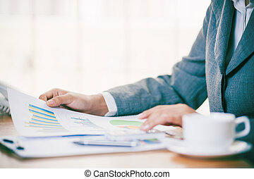 Business person analyzing business chart
