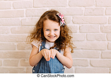 Little girl pretending to be a bunny - Portrait of smiling...