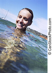 A beautiful young womans portrait in the water - A stock...