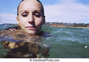 A beautiful young woman's portrait in the water. - A stock...