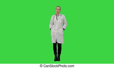 Smiling beautiful woman in lab coat talking to the camera on a Green Screen, Chroma Key.