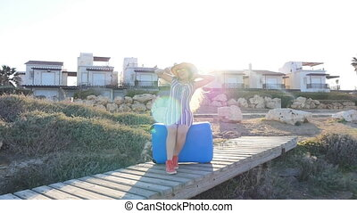 Young woman-traveler rejoices
