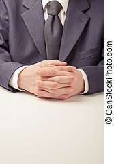 Negotiations - Man in business suit sitting at the table