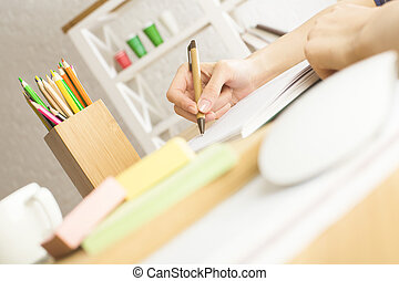 Woman writing in notepad - Close up of woman hands writing...