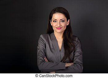 Beautiful smiling business woman in grey suit looking happy...