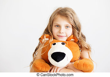 Little girl with big teddy bear having fun laughing Isolated...