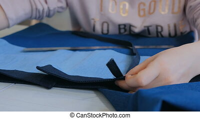 Professional tailor, designer measuring suit jacket for...