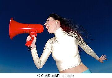 A stock photograph of a beautiful woman yelling into a mega phone.