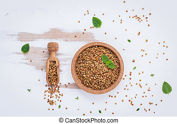 Raw organic bee pollen on shabby wooden board