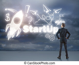 Start up concept - Back view of young businessman looking at...