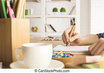 Girl writing in notepad - Close up of girl hands writing in...