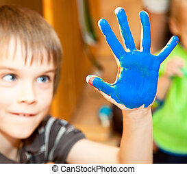 Fingerpaint - Happy boy ready to do a hand print