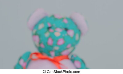 Dolly shot of teddy bear. White background. Selective focus...