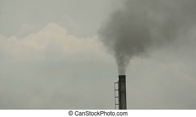 The industrial chimney is emitting exhaust fumes that...