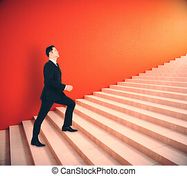 Achievment concept - Side view of young businessman climbing...