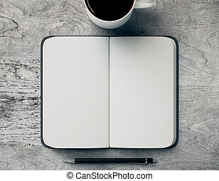 Blank copybook and coffee mug - Top view of grey table with...