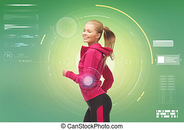 smiling young woman running over green - fitness, sport,...