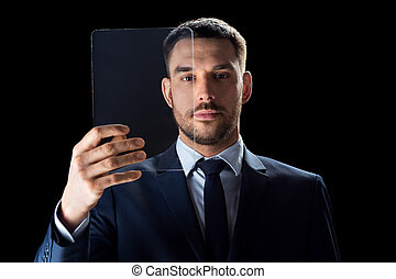businessman in suit working with transparent tablet pc -...