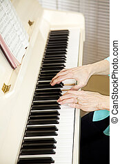 Pianist Plays Church Hymns - Closeup of a church pianists...