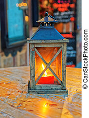 Burning lantern on table Garmisch Partenkirchen - Burning...