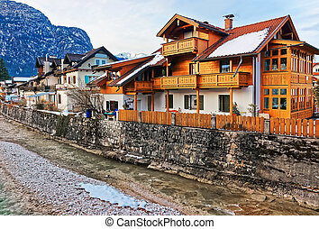 Alps Partnach River and wooden Chalets of Garmisch...