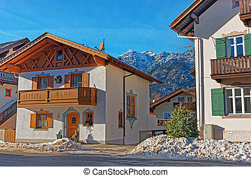 Street with Chalets and Alps at winter Garmisch...