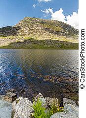 Pen yr Ole Wen mountain with Lake Llyn Ogwen in the...