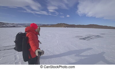 Two lovers on the lake ice. - Two lovers travel along the...