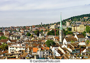 Fraumunster Church and rooftops of old city center Zurich -...