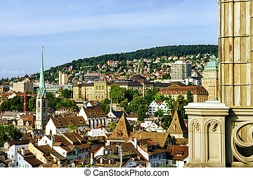 Fraumunster Church and rooftops of old city center of Zurich...
