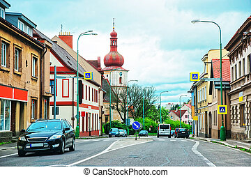 Street view with church spire in Poland