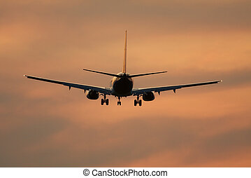 Plane - Airliner against sunset sky