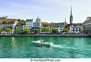 Fraumunster Church and motor boat at Limmat Zurich -...