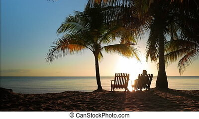 Two Chairs Placed in the Sand - Idyllic scene with two...