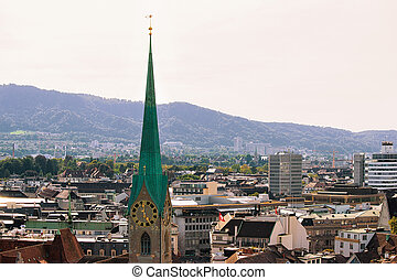 Spire of Grossmunster Church and rooftops in Zurich - Spire...