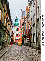 Cobblestone Street and St Stanislaus Church in Old town...