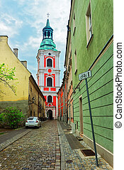 Cobblestone Street at St Stanislaus Church in Old town...