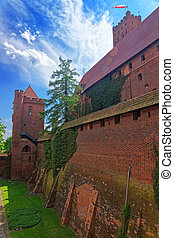 Walls of Malbork Castle also called as Marienburg, Teutonic...