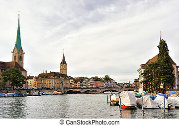 Fraumunster Church and St Peter and boats at Limmat Zurich -...